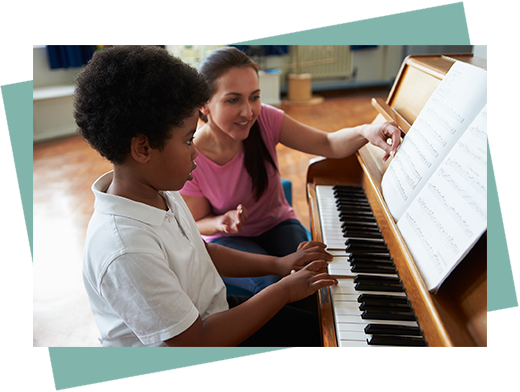 piano teacher and piano student having music lessons in toronto