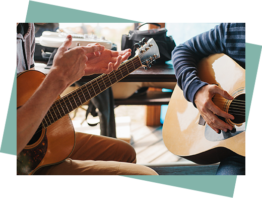 guitar lesson with teenager and guitar teacher